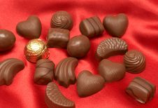 Free Valentines Chocolates On Red Silk Royalty Free Stock Photos - 4159738