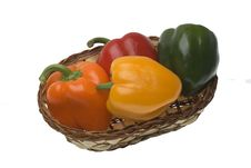 Red, Green, Yellow And Orange Pepper In The Basket Royalty Free Stock Photography
