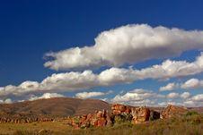 Free Desert Stones On Red Soil Agai Royalty Free Stock Images - 4165779