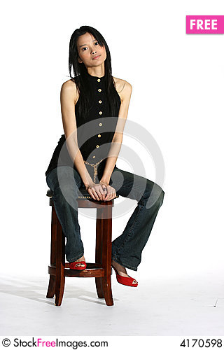 Free Attractive Asian Woman Sitting On A Stool Royalty Free Stock Photos - 4170598