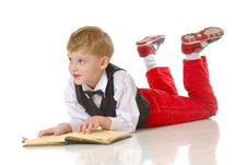 Free Young Boy Reading Book Stock Photo - 4171160