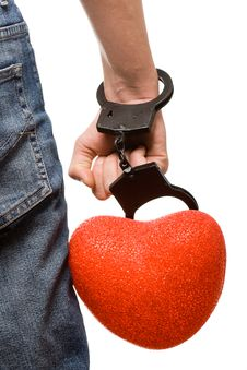 Man Hand With Handcuffs And Heart Royalty Free Stock Image