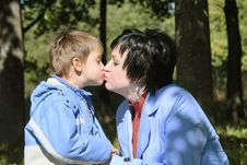 Free Mother Kisses Her Son Royalty Free Stock Photography - 4174697