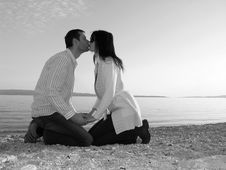 Free Young Couple Kissing At The Be Royalty Free Stock Image - 4175656