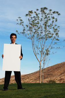 Free Businessman Holding Blank Board Royalty Free Stock Photo - 4177045