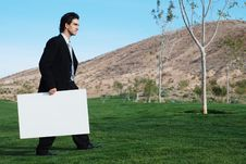 Free Businessman Holding Blank Board Stock Photography - 4177052