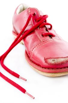 Free Damaged Red Shoes Kicking Stones Royalty Free Stock Image - 4178006