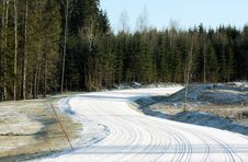 Snowy Road With Wheel Tracks Royalty Free Stock Images