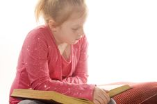 Free Little Girl Is Reading A Book Stock Photo - 4185780
