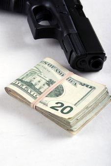 Gun And Money Royalty Free Stock Photos