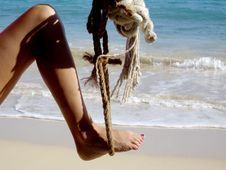 Free Woman S Leg In A Rope Swing Stock Image - 427581