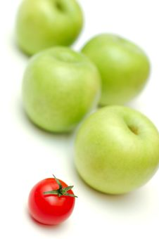 Red Tomato And Green Apples Royalty Free Stock Image