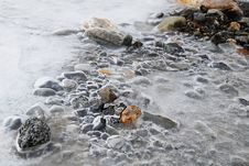 Frozen River And Egg Stones Stock Images