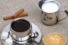 Free Cup Of Black Coffee With Muffin, Milk And Cinnamon Stock Image - 4207731
