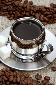 Cup Of Coffee With Lump Sugar And Beans Stock Photography