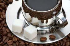 Cup Of Coffee With Lump Sugar And Beans Royalty Free Stock Photos