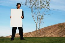 Free Businessman Holding Blank Board Royalty Free Stock Photos - 4208058
