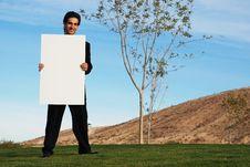 Businessman Holding Blank Board Royalty Free Stock Photos
