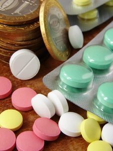 Free Pills And Coins 1 Stock Image - 4213261