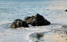 Free Rocks In The Ocean Surf Royalty Free Stock Photos - 4215788