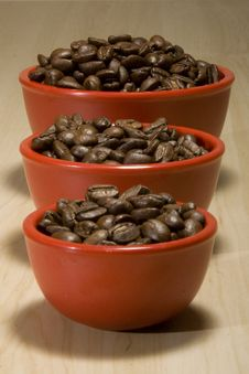Coffee Beans In Red Bowls Royalty Free Stock Photography