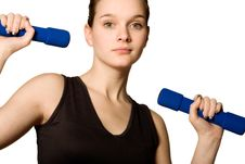 Free Young Girl Is Holding The Weights Royalty Free Stock Photography - 4221337