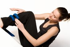 Free Woman Is Binding Weights On Her Leg Royalty Free Stock Photo - 4221845