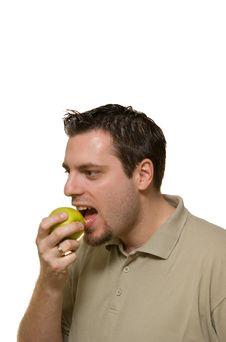 Young Man Eating A Green Apple Stock Photos