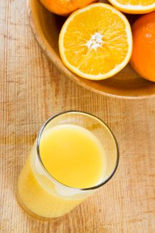 Free Orange Juice With Oranges Royalty Free Stock Photo - 4224385