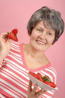 Senior With Strawberries Stock Images