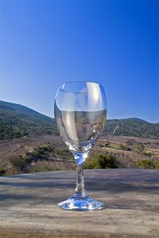 Free Empty Wine Glass Against Landscape Royalty Free Stock Photo - 4235875
