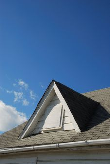 Roof Gable And Blue Sky
