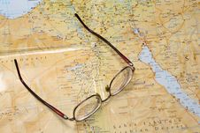 Glasses Laying On A Map Stock Images