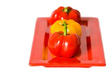 Free Red And Yellow Bellpeppers On A Red Serving Plate. Stock Image - 4248561