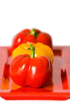 Macro Of Bellpeppers On A Red Plate. Royalty Free Stock Photo