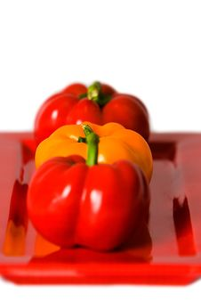 Macro Of Bellpeppers On A Red Plate. Royalty Free Stock Image