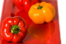 Free Bellpeppers On A Red Serving Dish. Royalty Free Stock Image - 4248886