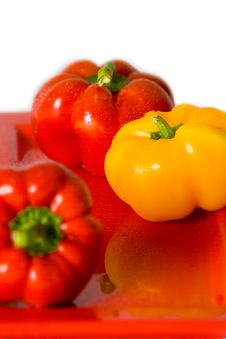Free Bellpeppers On A Red Serving Dish. Stock Photography - 4248942