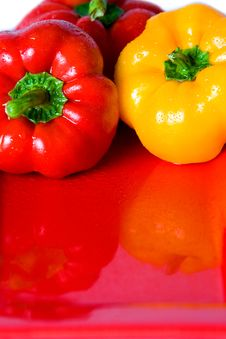 Free Bellpeppers On A Red Serving Dish. Stock Photo - 4249180