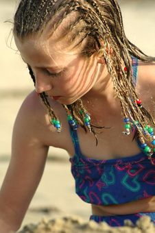 Free Girl Playing In The Sand Royalty Free Stock Photo - 4251025