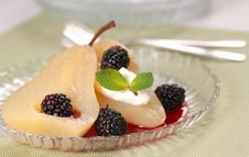 Pear Poached In White Wine With Blackberry Sauce Stock Images