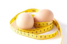 Eggs And Metric Tape Isolated Royalty Free Stock Photos