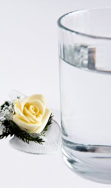 Rose And A Glass Of Water Royalty Free Stock Photos