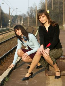 Free Girls Waiting For The Train Stock Photos - 4259613
