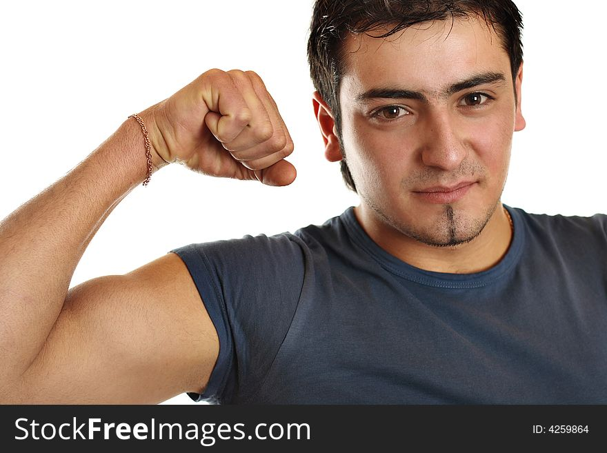 A bronze man is demonstrating his biceps