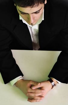 Free The Businessman In A Suit Sits At A Table Stock Photos - 4260473