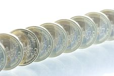 Euro Coins Line With Reflection Stock Images