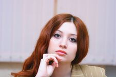 Girl With Reddish Hair In Office Royalty Free Stock Images