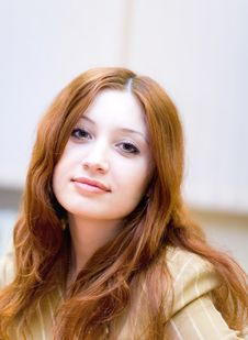 Girl With Reddish Hair In Office Stock Photo