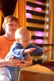 Free Mother Holding Enjoying Baby Stock Photography - 4268932